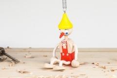 Pinochio na pružině červený