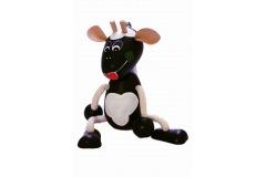 Černá kravka na pružině